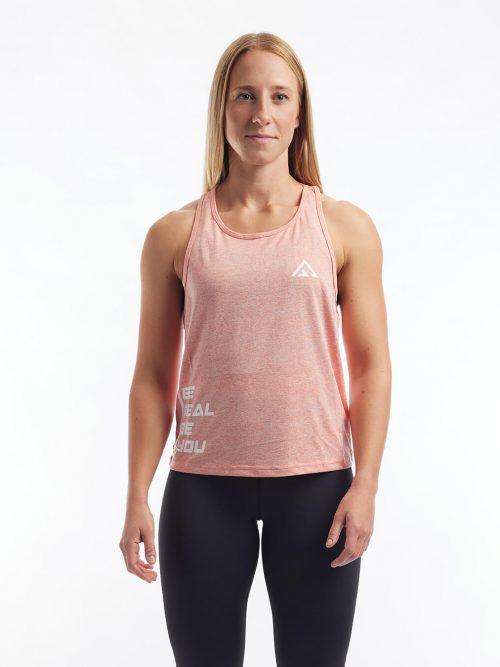 Rosa träningslinne i material som andas med text. Ljusrosa sporttopp i polyester.